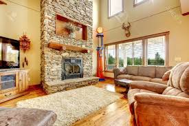 living room room with fireplace and tv brown tile pattern area rugs square fabric storage