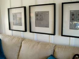 Decorations:Great Living Room Design Ideas Using Arranging Photos Frame On  Wall Including Tufted Hanging