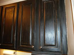 black stained kitchen cabinets distressed