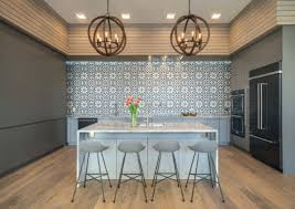 the wall tiles warm up the masculine and contemporary look of this kitchen image cbd lofts
