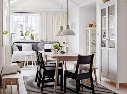 a um sized dining room furnished with a white stained solid birch table and four chair