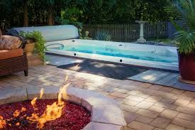fire pit and hot tub backyard