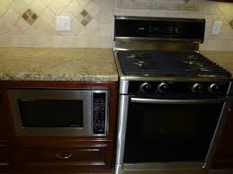 Kitchens With Giallo Ornamental Granite Backsplash Tiles With Giallo Ornamental Diagonal Or Straight
