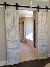 Master bath entrance with our antique French paneled doors, whitewashed and  hung barn door style