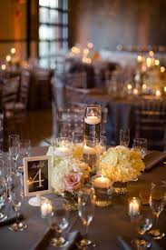 Similar concept as floating candle centerpiece. Instead of white hydrangea  use colorful, light blooms.