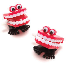 two sets of wind up false teeth