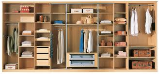 oversize wardrobe closet made of solid wood in light brown color scheme having several open shelves