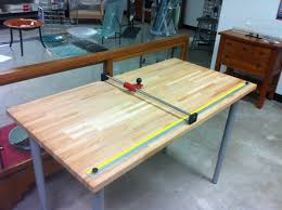 we built a quick glass cutting table using ikea parts it took about three hours we used a custom slide bar but a 30 would hang off 1 4 on each side