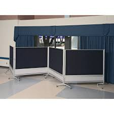 blue white office space. blue curtain in window also black screen on white ceramic flooring tiles large office room space