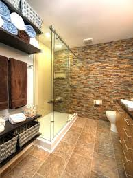 master bathroom with stacked stone wall and open storage