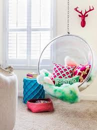 chic teen girl s room features a pink decorative deer head over an acrylic hanging bubble chair candelabra home bolo chair lined with pink and green