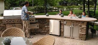 custom built outdoor kitchen with concrete countertop