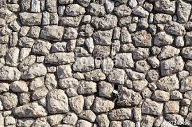 natural contrast masonry wall stone granite is a pattern of texture material and background with