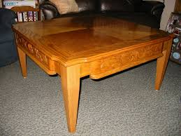 tapered legs add to the detailing of this red oak coffee table