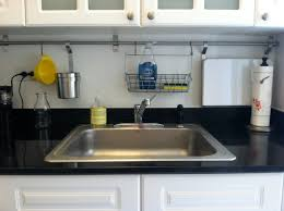 small dish drying rack near sink on white wooden kitchen set
