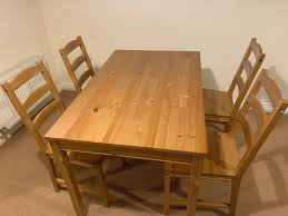solid and sy wooden table 4 wooden chairs
