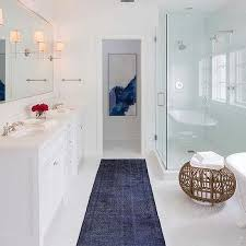 white and blue contemporary bathroom with dark blue overdyed rug