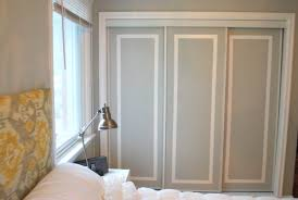 mirrored closet door makeover at the lettered cottage this would definitely bring in a whole lot of light to a room that s been so dark for so long