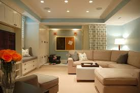 cozy living room design with corner brown sofa and square white table plus white shade floor lamp combine with beige floor and blue wall also ceiling lights bedroom bedroom ceiling lighting ideas choosing