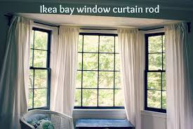Finally, I came across a blog (don't remember which one) that showed how  you can use a bendable curtain rod from Ikea to make a bay window rod.