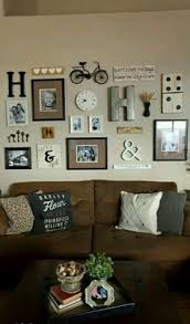 incredible family picture wall neutral colored gallery wall with orted frames and odd bits note three larger photos with same color mats