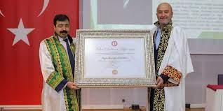 Mehir Vakfı Başkanı Özdemir'e Fahri Doktora
