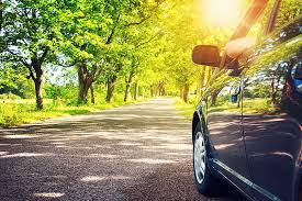 car driving down road. Brilliant Down Blue Car Driving Down A Sunny Street Lined With Greenery And Trees Inside Car Driving Down Road T
