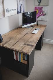 i built this desk out of a 100 year old wood door from my barn and ikea shelves i cleaned it and finished it with clear coat