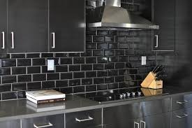 stainless steel kitchen cabinets with black subway tile backsplash