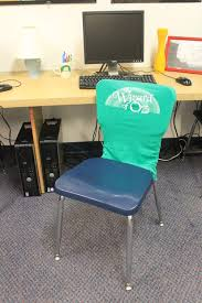 classroom chair back. take the finished cover and stretch it over chair back. felt a bit like dressing an unruly toddler because i made opening small to classroom back