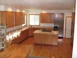 oak cabinets sizg with white granite countertops honey wood floors