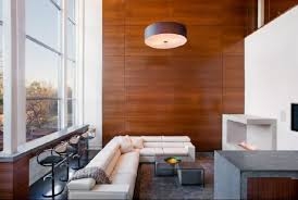 view in gallery a living room with high ceilings and an imposing walnut accent wall