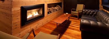 escea indoor gas fireplace featured in a stylish traditional wooden surround