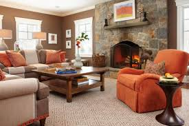 View in gallery Couch in orange makes for an interesting visual when placed  near a fireplace