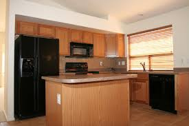 ... wood kitchen idea with modern black appliances and venetian window  blinds ...