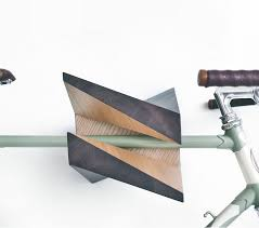this unique wooden bike hanger aptly named iceberg due to its somewhat similarity to an iceberg is a bicycle mount that you can use to hang your bike up