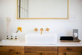 A West Elm Reclaimed Wood + Lacquer Buffet Has Been Repurposed As A  Stunning Vanity Topped With A White Quartz Vanity Top Holding Two Vanity  Trays Flanking ...