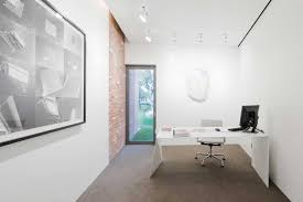 white office design. Extremely Minimal White Office Desk In A Bright With Picture On Wall As Well Large Rug Design