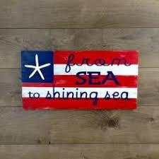 beach street signs coastal signs of sea level dan word