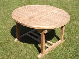 round extending teak garden dining table
