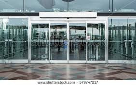 building glass door. airport terminal building gate entrance and automatic glass door i