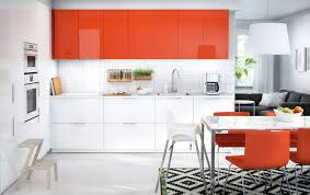 A Kitchen With White And Orange Doors Combined With White Appliances,  Orange Leather Chairs And