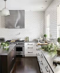 White Kitchen Cabinets with Stainless Steel Countertops