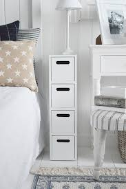 white narrow bedside table with drawer