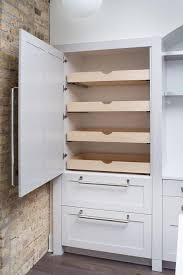 pull out shelves for kitchen cabinets. fabulous kitchen features concealed pantry cabinets fitted with stacked pull out drawers next to an exposed shelves for o