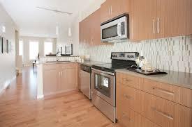 White Stone Kitchen Backsplash Open Concept L Shaped Kitchen With Stainless Steel Appliances