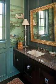 lisa hilderbrand cool bathroom with chinoiserie wallpaper and saturated green trim