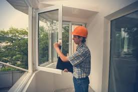 a glass king tech is working on replacing a broken window glass king offers the