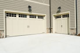 carriage house garage doors in denver what s the most elite way to emphasize curb appeal in a residential garage door replacement in denver