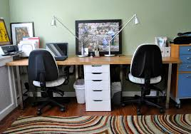 2 person desk ikea with wooden tops and metal legs combined with file  cabinets and swift